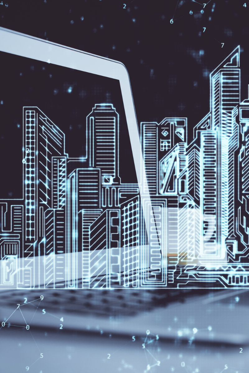 desktop computer background in office and big town buildings hologram drawing. double exposure. smart city concept.